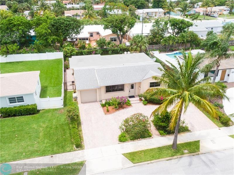 PRISTINE 3 bedroom / 2 bath home in one of the MOST DESIRABLE sections of West Palm Beach!  A SPLIT PLAN, this home features COMPLETELY RENOVATED kitchen with DOUBLE OVENS, PREMIUM Italian Tile Floors, HURRICANE SHUTTERS throughout and IMPACT FRONT and GARAGE DOORS!  Over 1800 square feet, this OPEN FLOOR PLAN is highlighted by OVERSIZED family/dining room, EXPANSIVE living room, and GORGEOUS kitchen with CUSTOM BREAKFAST island perfect for casual dining!  Situated on a LARGE LOT that is FULLY FENCED in, has ROOM for a POOL, and COVERED patio to enjoy that