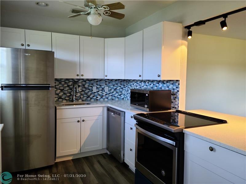Almost everything is new in this condo.  Wait until you see all the upgrades.  New cabinets, quartz countertops, new kitchen appliances, new washer and dryer, new AC; the list goes on.  New waterproof vinyl flooring makes cleaning a breeze.  Great view from every window.  Priced to sell.