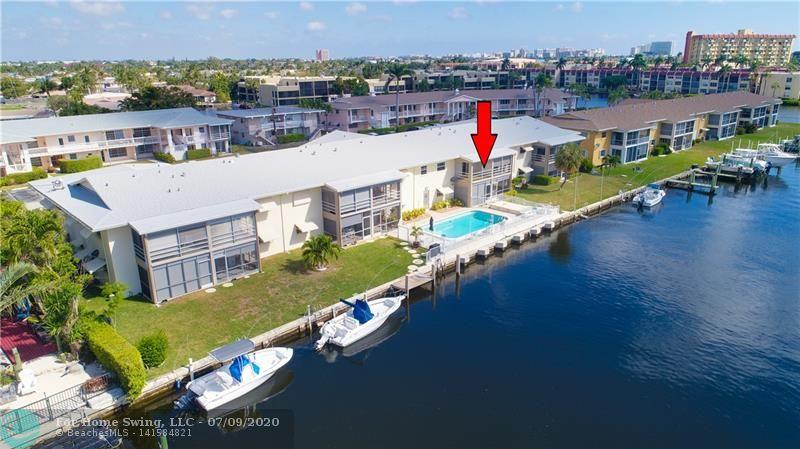 AFFORDABLE, WATERFRONT 55+ CO-OP! This clean, spacious 2/1 is located on a quiet residential cul-de-sac. Waterfront 2 bedroom, 2 bath Co-Op in Pompano Beach.  Unit has New impact windows and doors and is freshly painted. This great unit sits right on the water with awesome pool and canal views from your private screened balcony.  Spend time in your spacious living and dining room with tons of natural light.  Dockage for rent when available and only have the Federal Highway bridge to get to the Intracoastal and Ocean. Lots of grass and patio down by the poo