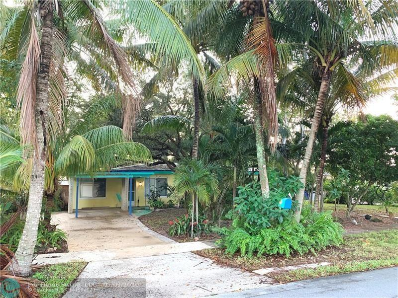 """Old Florida charmer with """"Key West"""" flair. Open and spacious 3/2 in Lyons Park. The finishes & decorations in this relaxed & comfortable home make it feel like you are in the keys. Beautiful terrazzo floors, light, bright & open family room. Bonus room can be office, study or 4th bedroom. Impact windows. Newer A/C. Newer W/D.  Lush landscaping.  Neighborhood has sidewalks."""