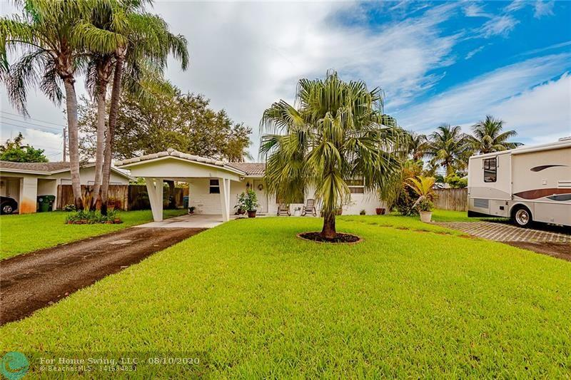 Lovely Family Home with 3 bedrooms and 2 bathrooms.  Updated Flooring throughout with a extra large Great Room 18X20.  Impact Windows, Impact Doors.  Gas Stove, Gas Dryer.  Well pump for Sprinklers will save lots of money.  PERFECT PARKING FOR A  R.V.  OR LARGE BOAT  DOUBLE DRIVEWAY!    NO HOA!