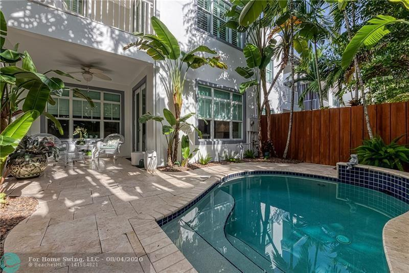 Don't miss this lovely 3 bedroom, 4 bath town home with pool & 2 car garage. Located only 3-5 minutes from Downtown Ft. Lauderdale, Riverwalk, Waterfront Annie Beck Park & Las Olas Blvd shops & Dining.  This town home has been filled with designer touches & is move-in ready!  The kitchen is a chef's dream with large island, double oven & gas range.  The living & family room is perfect for entertaining and provides great views to the tropical backyard & pool. Each bedroom is spacious & offers great closet space.  The private backyard is fenced with tropical