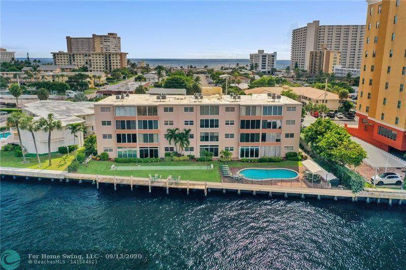 """PRICE REDUCED! NOW IS YOUR CHANCE! DIRECT INTRACOASTAL VIEWS! ALL NEW IMPACT WINDOWS & DOORS JUNE 2020, NEW A/C & HWH 2016, NEW SS MICRO JUNE 2020, GORGEOUS GRANITE counters & breakfast bar OPEN to dining & LR. Ceramic tile on the diagonal in ALL ROOMS, baths have new vanities, fixtures & toilets. FULL SZ.WASHER & NEW DRYER IN UNIT, ALL NEW FURNITURE NEGOTIABLE! LG ROOMS & PLENTY OF STORAGE, FLORIDA RM OVERLOOKS THE """"T"""" OF THE ICW & CANAL. CONSTANT YACHT/BOAT PARADE! COMPLEX FEATURES-HTD POOL-SHUFFLEBOARD COURT-CANOPY COVERED TABLE FOR 10-GAS BBQ GRILL-A DOCK DIRECTLY ON THE INTRACOASTAL (for PICK UP by boat OR DROP OFF ONLY) TO VIEW THE INCREDIBLE SUNSETS. ALL this JUST BLOCKS to newly renovated SANDIEST FLORIDA BEACH, NEW ON THE SAND REST"""