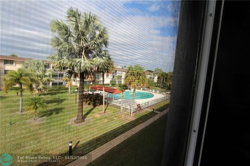 Beautiful 2 bedroom 2 bath condo located in the heart of Lighthouse Point. Windows are Impacted, a nice patio overlooking the pool and gardens.  Kitchen cabinets and countertop updated, newer appliances and A/C is 2 years new. new wood floors throughout. Faux wood shutters cover the bedroom windows, nice walk-in closet. Please call to see this very clean and partially updated unit today.