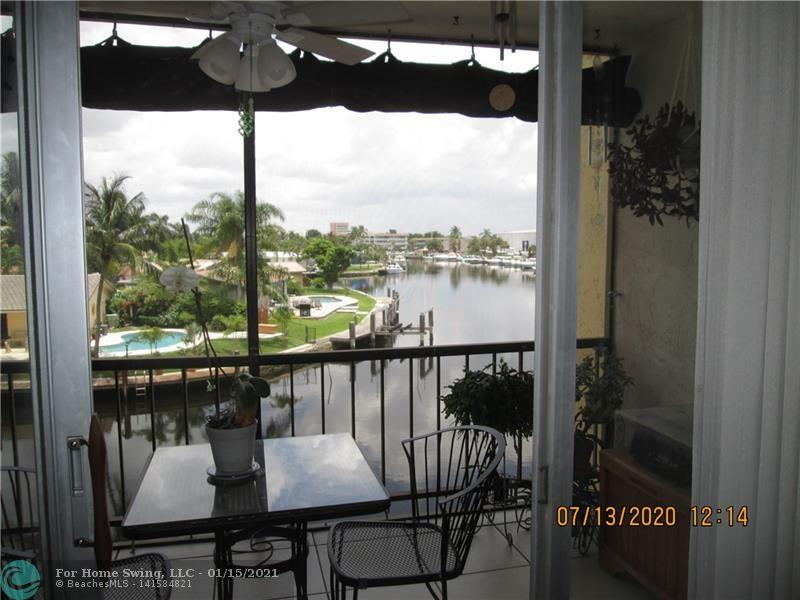 Hello water view! Relax on the balcony looking over the wide canal. Good sized 2 bedroom/2 full baths.  Lots of storage. Gated community, close to shopping and the beach.  This unit is close to the pool,BBQ area, community rooms.  Hurricane protected. Partially furnished.