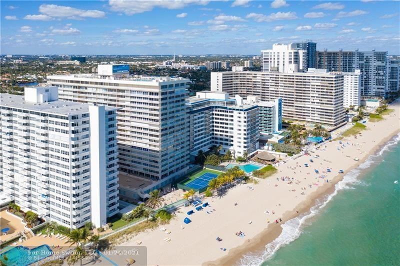 """REMODELED CORNER UNIT ON PERFECT FLOOR LEVEL IN BUILDING WITH FLOOR TO CEILING WINDOWS.  SPECTACULAR VIEWS DAY AND EVENING. OPEN KITCHEN TO OVER SIZE LIVING ROOM, WHICH LEADS TO BALCONY. ENJOY DINING ON YOUR WRAP AROUND BALCONY WITH SUNSET AND OCEAN VIEWS. LARGE BEDROOMS WITH WALK IN CLOSETS. CABLE AND INTERNET ARE INCLUDED IN MAINTENANCE. AMENITIES - ROOF TOP HEATED POOL (AN EXCLUSIVE ON THE BEACH), SKY LEVEL GYM WITH OCEAN VIEWS, TENNIS COURT BEACH SIDE, 24 HOUR DOOR PERSON TO GREAT YOUR GUESTS. GARAGE PARKING AND AN ABUNDANCE OF GUEST PARKING. ACROSS THE STREET FROM OCEAN CLUB IS SHOPPING AND RESTAURANTS.******MOVE RIGHT IN...OFFERED """"TURN-KEY""""******"""