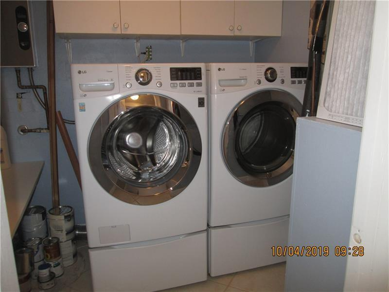 Utility room with waher/dryer and tankless water heater