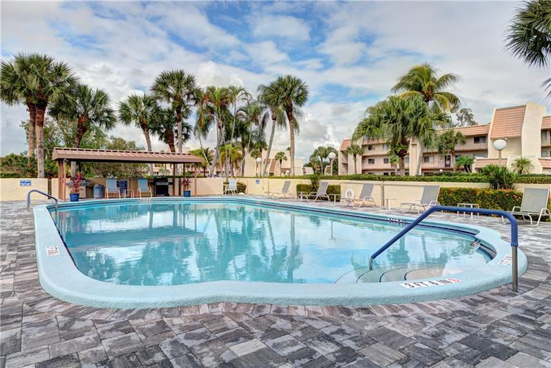 Pool and BBQ area Just steps away from unit