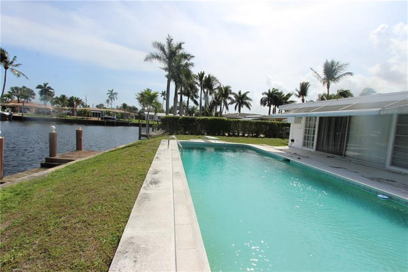 "THIS IS A UNIQUE POINT PROPERTY, CONSISTING OF A FREEFORM SWIMMING POOL, 3 BEDROOMS,2 BATHS, PATIO OVERLOOKING CANAL. LOT IS 13,624 SQ. FT. APPROX. 200 FT WATER. HOUSE AND PROPERTY SOLD IN ""AS-IS  CONDITION""  THERE IS ONLY FED. HWY. BRIDGE. THIS IS AN ESTATE SALE AND IS BEING EMPTIED AND PREPARED. PLEASE DO NOT GO ON PROPERTY UNTIL FURTHER NOTICE. CALL AGENT WITH ANT QUESTIONS"