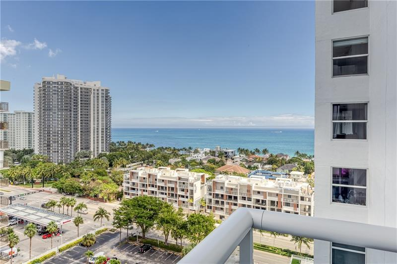 High floor bright and airy beach pied-a-terre. Gorgeous Ocean & Galt Mile views!! 2 short blocks to beach. Murphy bed. IMPACT WINDOWS. Total bldg reno. Updated lobby, hallways, clubroom, gym, tennis, pickle ball. infinity heated pool, BBQ pavilion, green turf, walking track, bocce ct. Monthly fees include reserves, dedicated hi speed CAT 5 fiber optic Internet, HDTV, 24hr concierge, bike/kayak storage. GARAGE PARKING. Resident must purchase car tag for the garage $50. 2 pets, 20# max. Bayview School District.   Laundry and storage next door to unit. Pool still under construction. Close to shopping, fine dining, water taxi, pharmacy, post office, and public transportation, Proposed contemporary Publix will be built across the street on 30th.