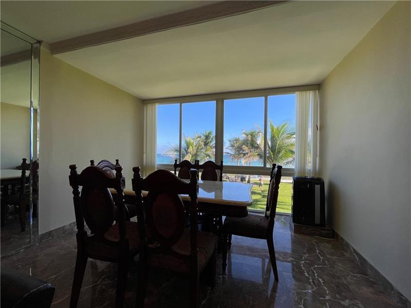 Flexible floor plan, currently this area used for Dining with fabulous views of the ocean!