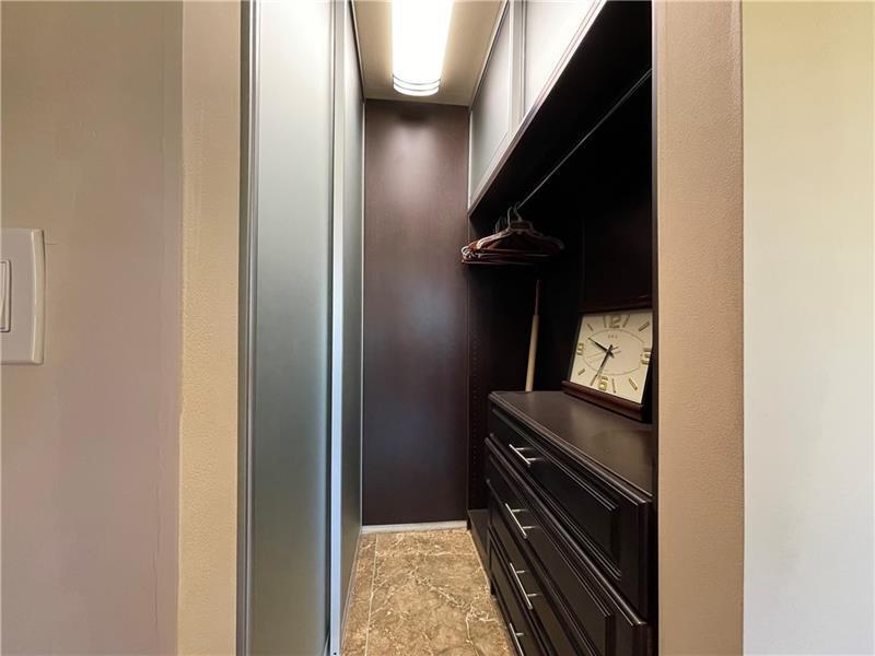 Custom closet cabinetry in Primary bedroom