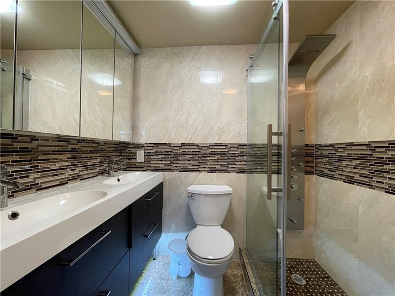 Second bedroom???s en-suite bathroom with double sinks