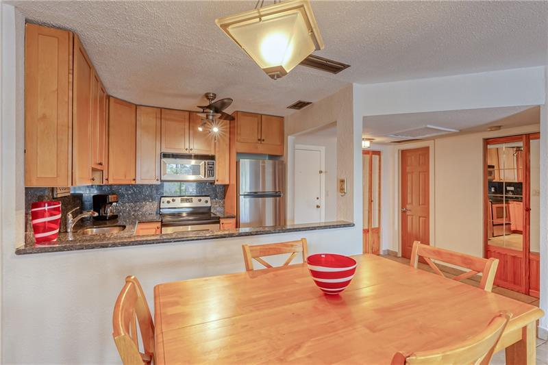 THIS IS IT!!! Beautiful and spacious 1/1 in east Pompano Beach. Granite counter tops, stainless steel appliances, wood kitchen cabinets, tile floors throughout, walk-in closet, impact windows PLUS accordion storm shutters, plenty of storage, including a storage room off your spacious, screened BALCONY. Super clean and FREE laundry facilities steps down the hall. Second floor unit in a secure building with security cameras. 1 assigned parking spot and plenty of guest parking. This is a small and quiet complex in a residential area, close to shopping, restaurants and schools, and just 10 minutes to the beach, and 20 minutes to Fort Lauderdale airport. Unit is located near the HEATED pool, clubhouse. 1 pet ok, up to 20 lbs. NEW ROOF, job almos