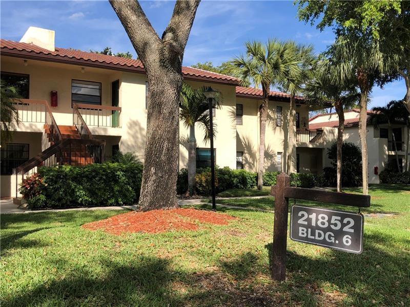 VERY SPACIOUS 2/2 condo in pet-friendly 55+ community. This second floor unit has a large screened-in patio overlooking the golf course. Large walk-in closets. Washer and dryer in unit. Your pet is welcome in this very well maintained no-carpet unit. 1 pet under 25 lbs. with a $250 non-refundable pet deposit. Gated community with 24-hour manned security gate. Pool and other amenities. This unfurnished annual rental is ready for you!! Enjoy a peaceful community minutes away from great dining and shopping in Boca Raton. ***As per association no trucks, minimum credit score 600, at least one occupant must be 55+. No elevator. 1 assigned parking spot + guest parking.