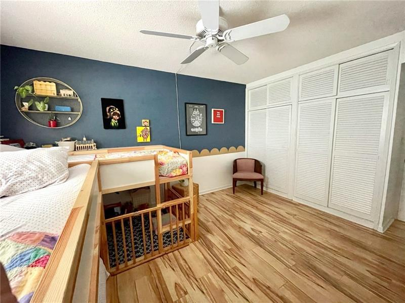 Second bedroom with overhead ceiling fan