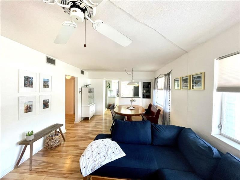 Living room / Dining room is large and spacious with wood laminate flooring