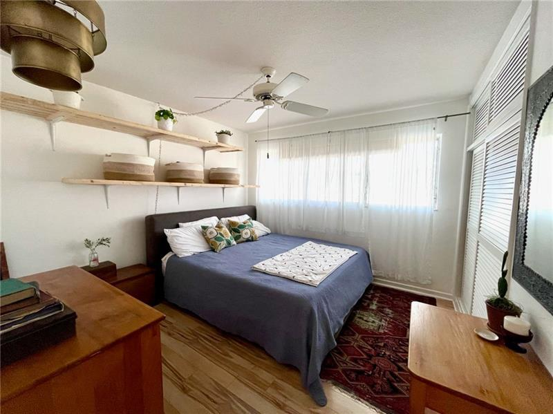 Bedroom is spacious with tons of natural light
