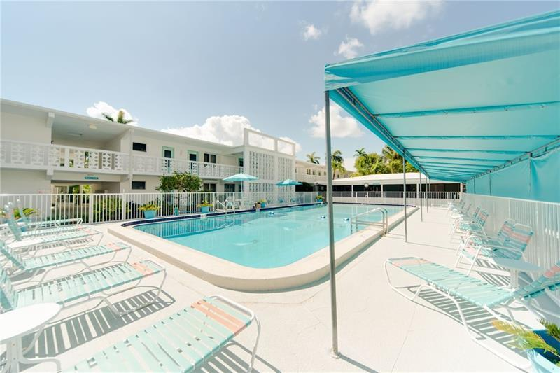 Large community pool with spacious sundeck