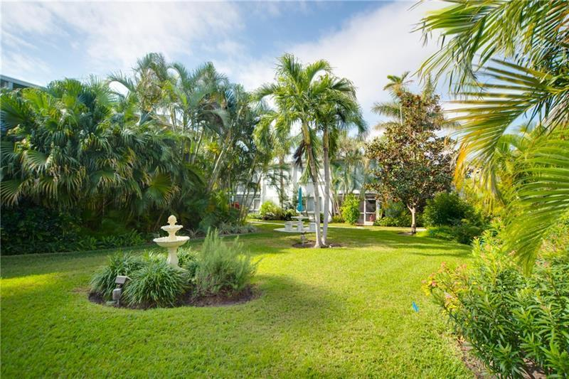 Tropical landscaping with tables and fountains around the grounds