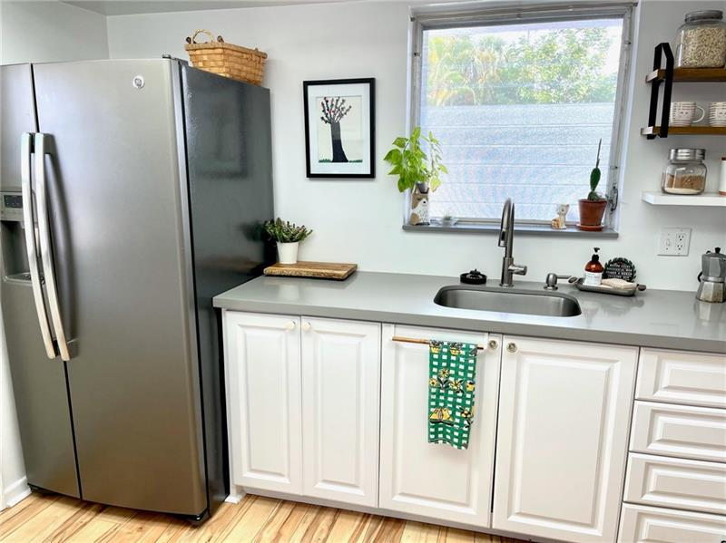 Stainless steel appliances with kitchen window to provide additional lighting
