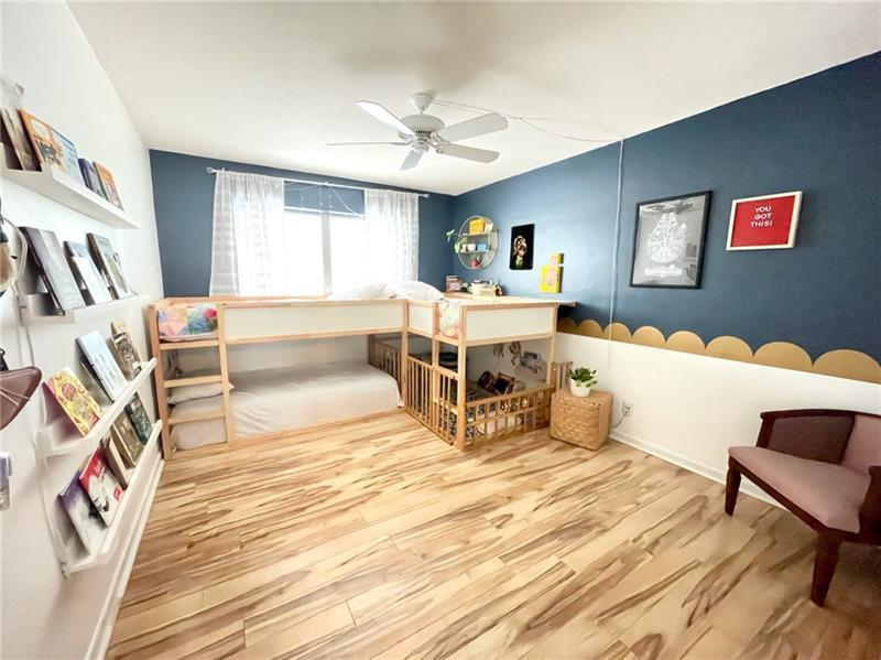 Large bedroom with laminate wood flooring