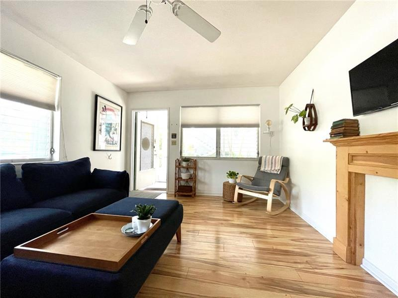 Large and spacious living room with laminate wood flooring