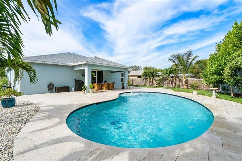 Welcome to one of Yachtsman Cove's finest homes, a spacious and sun-drenched 2015 build with an extraordinary resort-style saltwater pool added in 2017, quick access to the boat ramp and Boynton Inlet, and a separate gate on the side of the house to PARK YOUR BOAT! Spend your days on the water with a fun-loving community of boaters and come home to oceans of space in your high-ceilinged, open floorplan home with an entertainer's kitchen and 4 spacious bedrooms on different corners of the house. Tropical-inspired upgrades like plantation shutters and impact windows complement the lush landscape of your fenced yard: Marble pavers, LEDs, covered lanai, fountains, fruit trees, a shed...No expense was spared in creating this outdoor oasis!