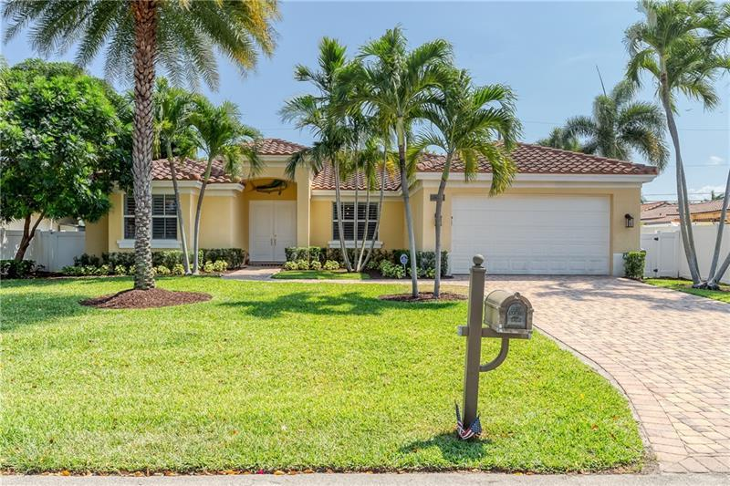 Enjoy this awesome Summit home built in 2011 located in the heart of Lighthouse Point. From the moment you walk in this 3 bed, 3 bath home your eyes are drawn to the volume ceilings & wall to wall sliders leading out to the pool. The home features a large living room, formal dining room & new kitchen in 2018. A cooks dream, this kitchen features quartz counters, bar seating, built-in breakfast area, wine bar & new Cafe' collection appliances. Huge master w/ 2 walk-in closets, large master bath w/ double vanity, walk-in shower & Spa tub. Entertain in your private, tropical oasis of a backyard that features large covered patio with electric & lighting, freeform pool and large fenced yard.  Other features include paver driveway, full impact wi