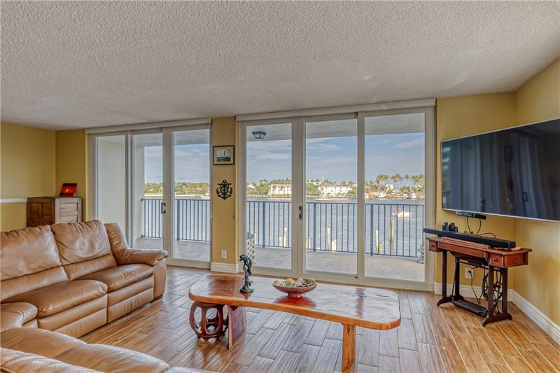 Living room leads out to super large balcony