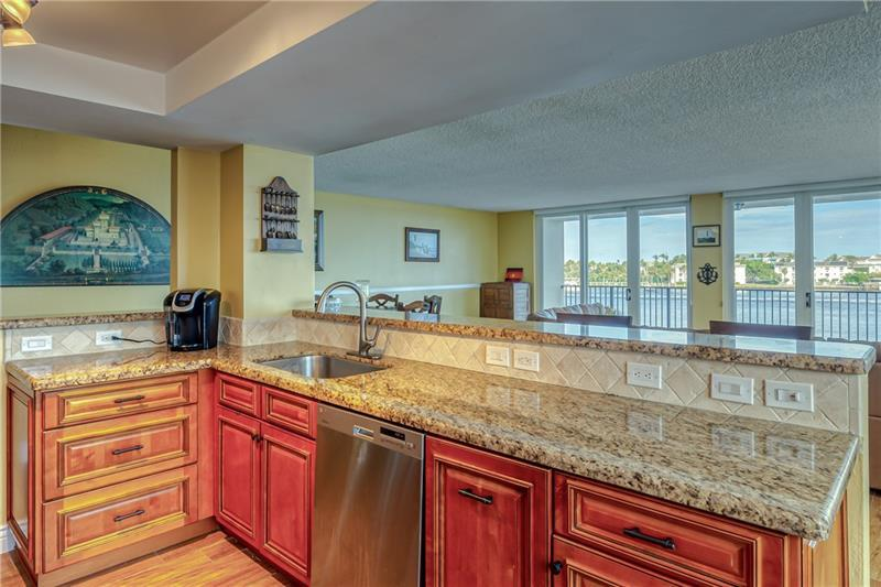 Large and spacious open kitchen with granite counter tops