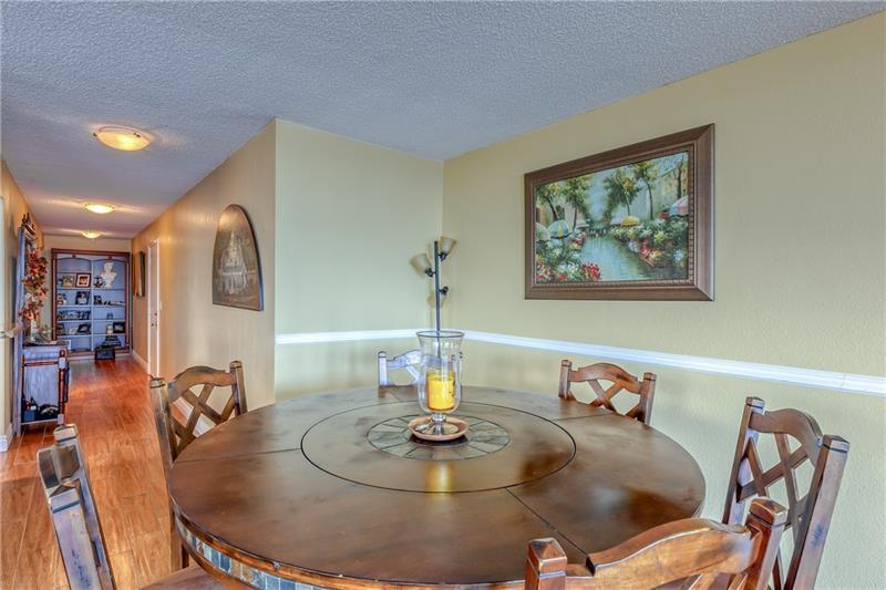 Large dining room with woodchair rail