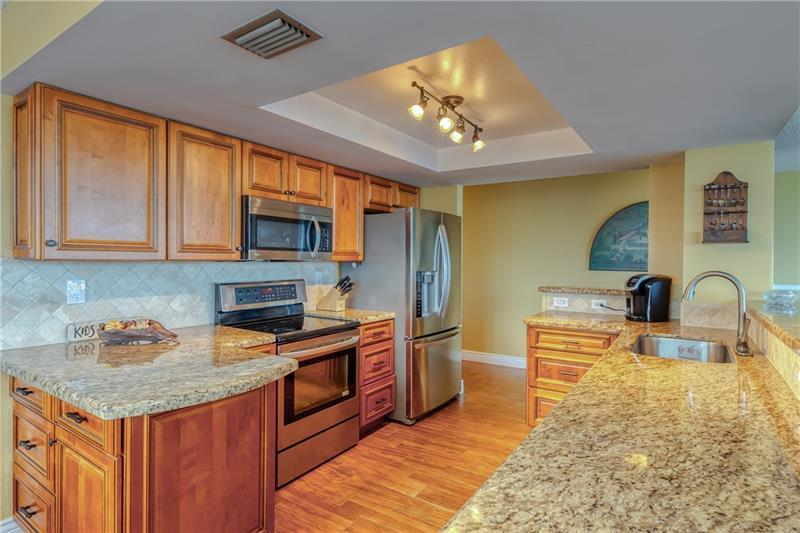 Wood cabinets and granite countertops in kitchen