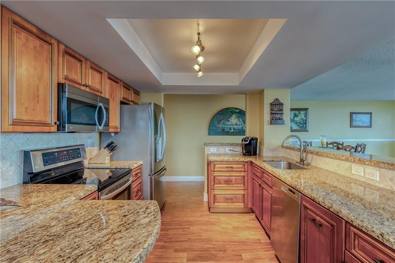 Large and spacious open kitchen with overhead lighting