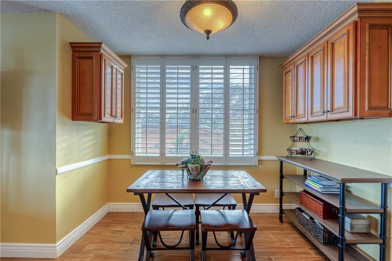 Eat in kitchen area with extra cabinets for storage