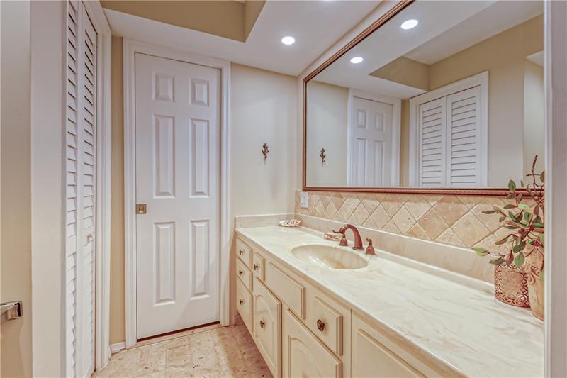 large bathroom with tile backsplash and flooring