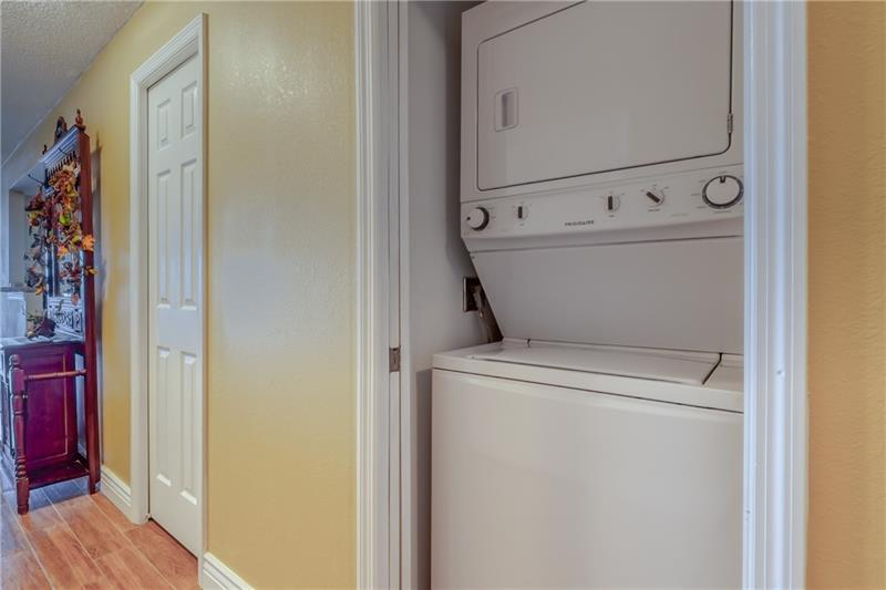 Stackable washer and dryer in the unit