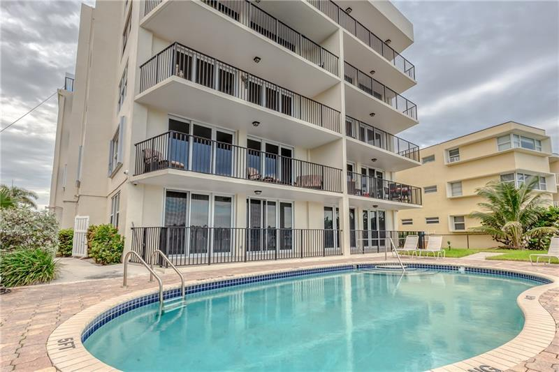 Pavered pool deck and condo pool