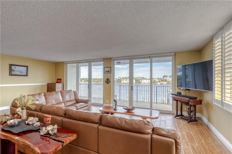 Living room with gorgeous Inlet views