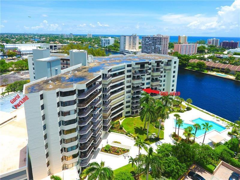 This building has fire sprinkler system. Most sought after South facing unit! Located on West side of the Intracoastal so no waiting on the bridge. Live the Florida lifestyle from your SE facing open balcony with intracoastal, ocean, & pool views! Renovated 2/2 split bedroom unit with Impact windows/sliders, full size W/D in unit, custom designer kitchen with high-end SS and quartz, tub & separate shower in master, 3 walk-in closets, 2 flat screen wall TV's stay, extra storage on the same floor as unit. Resort style heated pool directly by the water, BBQ, 24/7 security, 1 garage parking, plenty of guest parking, gym, sauna, car wash area, 2 pets up to 25lbs welcome! Located 2 short blocks to the beach, near restaurants, shopping, boat ramp