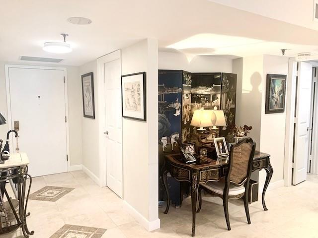 Wide foyer with nook for desk or entertaining center with bar.