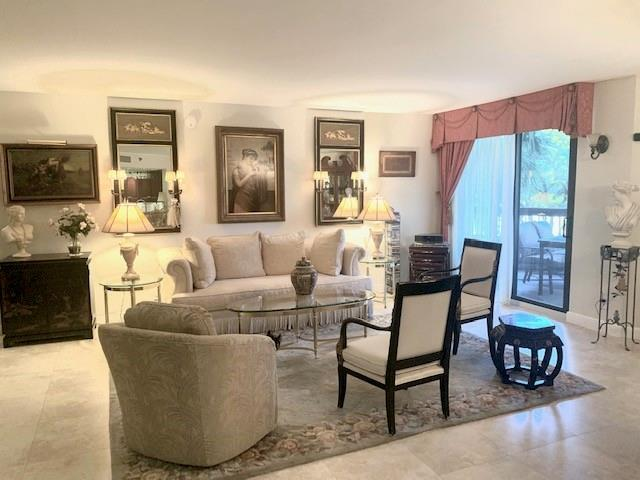 Completely remodeled unit with no popcorn, no wallpaper or no mirrors.  Open living area with same tile floors throughout, all hurricane impact sliders and accordion shutters.