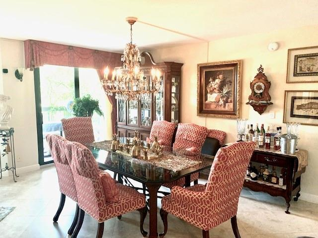 Open dining area.  Chandelier does not stay.