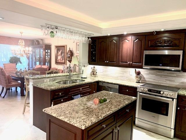 Remodeled kitchen has Open Floor plan to dining and living area.