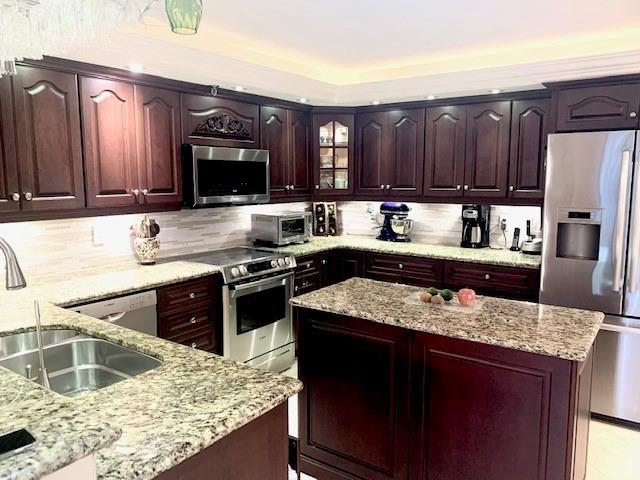 Beautifully remodeled kitchen with movable island, dome ceiling with recessed lighting.
