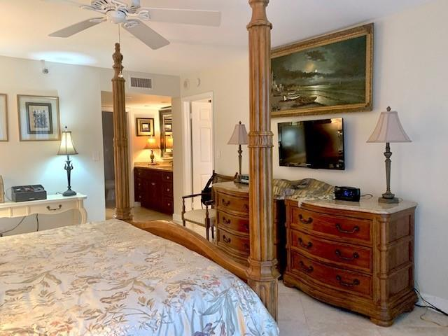 Main master suite with dressing area, dual sinks and oversize walk-in closet.