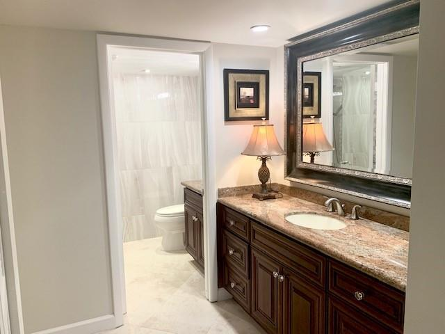 Dressing area in main master with dual sinks and oversized walk-in closet.