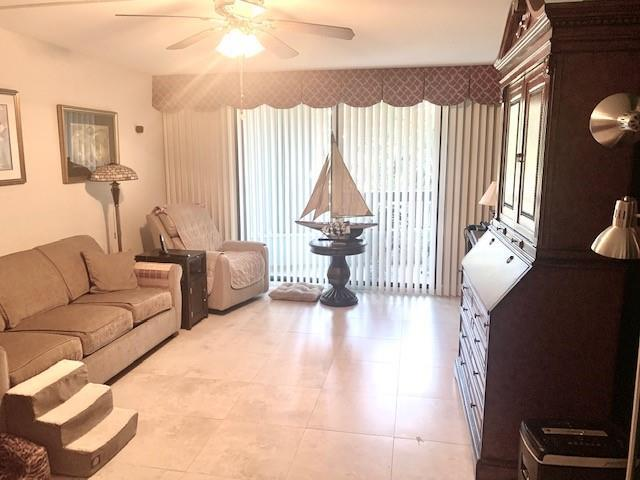 2nd Mater suite being used as a den.  Hurricane impact sliders that leads to the massive covered balcony.  Same Tile floors throughout the unit.