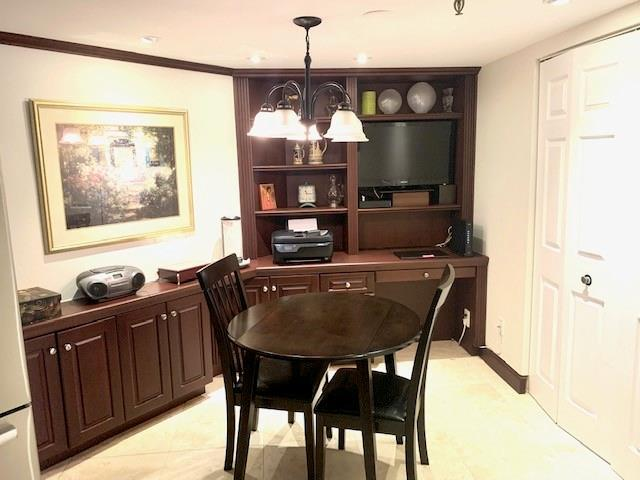 Custom kitchen cabinets continue with an eat-in kitchen area and built-in desk tucked away in the corner. This area also features an oversized pantry.  All this makes this a dream kitchen.
