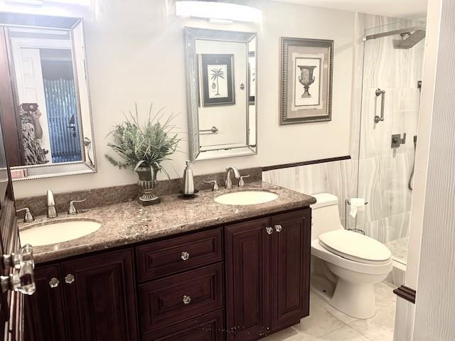 1 of 2 master baths completely remodeled with dual sinks and walk-in shower.